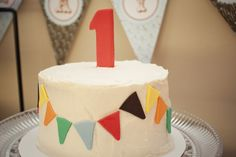 Carnival Themed Smash Cake with fondant bunting banner