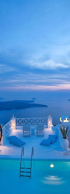 Hotel on the Rocks....Santorini, Greece. Perfect for me, the hubby, First Mate and her cabin boy. ;)