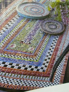 mosaic table by georgette - similar design would make a nice floor cloth or table cloth