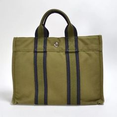 Authentic Hermes Shopping Tote Authentic HERMES Canvas Fourre Tout PM Green and Navy color. Preowned condition. Shows normal wear with some rubbing on corners and edges. Great every day shopping tote. Hermes Bags Totes