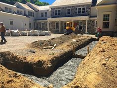 Laying down a the foundation for a new stone wall around this beautiful new…
