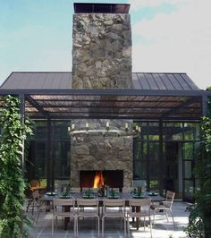 Exterior   Contemporary Patio Area With Stone Outdoor Fireplace Long Table  The Brown Chairs And The Iron Pergola: Artistic Pergola Design Id.