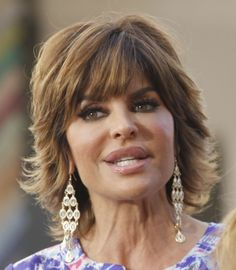 Lisa Rinna Photos Photos - Lisa Rinna speaks animatedly with Maria Menounos about her QVC clothing line during a taping of Extra at The Grove in Los Angeles on February 15th, 2013 - Lisa Rinna Visits Extra