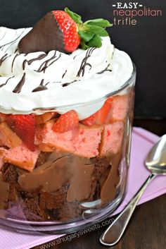 Easy Neapolitan Trifle recipe: layers of chocolate cake, pudding, strawberry cake, fresh berries and Cool Whip!
