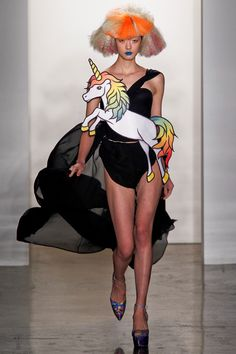 1990s Retro Pop Culture Fashion from Designer Jeremy Scott  By Rusty Blazenhoff on February 20, 2012    The Fall 2012 collection from American fashion designer Jeremy Scott is based in 1990s pop culture references. Many of his designs feature images from The Simpsons and others incorporate rainbows, unicorns, and emoticons. The entire collection can be viewed at fashion news site, Fashionista.