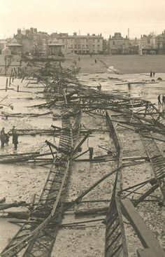 Description	Wreckage of Worthing Pier after it was destroyed in a storm in the night of 22-23 March 1913. View taken from far out on the beach at low tide showing twisted girders and other wreckage on the beach, entrance kiosks still standing at the top of the beach, Marine Parade buildings including the Pier Cafe in background.
