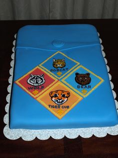 This is an 11x15 funfetti covered in fondant.  The button and patches are fondant as well.  The patches are hand painted with gel color.  I made this with my son for a cake auction fund raiser for the Cub Scouts.