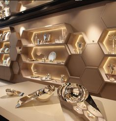 The new-look Christofle stores - Stephane Parmentier plays with the brand's heritage, using hexagonal forms Shoe Store Design, Jewellery Shop Design, Jewellery Showroom, Retail Store Design, Jewelry Shop, Jewelry Stores, Showroom Interior Design, Boutique Interior, Reception Counter Design