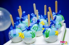 Decorated caramel apples at an Under the Sea Party. I thought they were cake pops (which would be very cute too)!