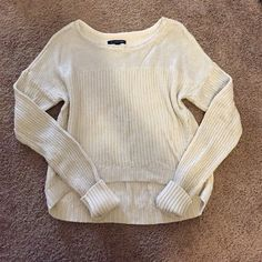 Metallic Knit American Eagle Sweater Very gently used. Cream knit sweater, light to medium weight, with silver metallic light coating effect. Slight high-low fit. Size small, fits true. Would look great with leggings or jeans for the holidays! American Eagle Outfitters Sweaters