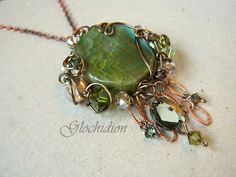 Queen of the Faeries wire wrapped pendant with Swarovski crystalized elements and semi precious stones in green and earthy tones. $59.00, via Etsy.