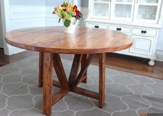 Step-by-step plans showing you exactly how to build a round dining table with trestle base for only $40 in lumber!