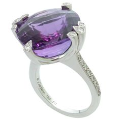CARTIER Amethyst Diamond White Gold Ring from Cartier's Inde Mysterieuse collection features a 17.0mm x 17.0mm x 11.0mm faceted amethyst stone beautifully set into 18k white gold and completed by an estimates 0.49 carats of sparkling round diamonds on the setting and the shank. Circa 2010.