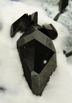 Black lustrous prismatic Neptunite crystals. Crystal Classics Minerals
