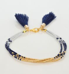 seed bead bracelet-gold, navy blue, and white-navy blue tassels-ombre-miyuki delica seed beads-boho chic-tassel bracelet #etsy #jewelry #bracelet #gold #blue #white #victoriasdesignsus #miyukidelica #miyuki #seedbeadbracelet #multistrandbracelet #ombre #bohochic #tassel #tasselbracelet #navyblue #tasseljewelry