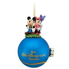 Walt Disney World Minnie and Mickey Mouse Ornament with Tinker Bell | Disney StoreWalt Disney World Minnie and Mickey Mouse Ornament with Tinker Bell - Celebrate your visit with this glittering ball ornament topped with Mickey and Minnie figurines. Tinker Bell leaves a trail of pixie dust across the globe for a souvenir that will sparkle in memory forever.