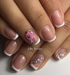 Girly Girl Spring Nail Art Design with Rhinestones. Embellish your nails with this pink flowered french tip nails along with the rhinestones in diagonal pattern.