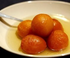 GULAB JAMAN - Indian and Pakistani Sweetmeat - deep fried dough balls (with paneer ot cottage cheese) are soaked in fragrant cardamom sugar syrup