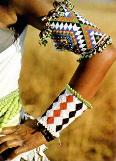 Africa | Beaded arm adornments ~ izingusha ~ from the Zulu people of South Africa | ©Stan Shoeman