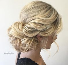 Curly wedding updo by Glam by Torie Bliss
