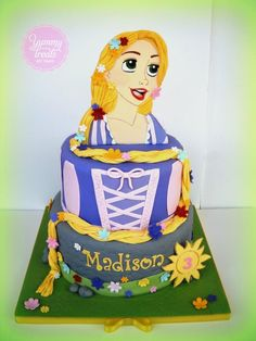 Rapunzel Cake - The original designer was Celebrate With Cake. I just twisted the second tier and board a bit. Rapunzel's face was hand painted in sugar. I hope you like it!