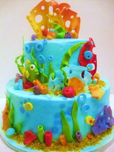 cute kid cake..I dont think this would be hard to do..time consumin' but not hard