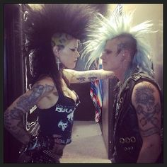up against a wall, punk couple, punk love, mohawks, leopard print