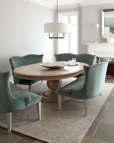 Personally - I find there to be proportion size problems here. The area rug is too small, the light fixture is too small. The velvet chairs look so cozy but so heavy and accompanied by the table add a bulk to the room that just doesn't work for me. Personally I'd take two of the velvet settee-ish chairs out.