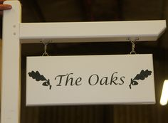 Cream painted oak post, arm with lettering in Farrow & Ball studio green. http://www.sign-maker.net/wooden/wooden--posts.html