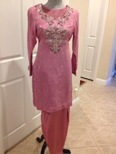 beautiful rose pink silky fabric with self print salwar kameez $47.00