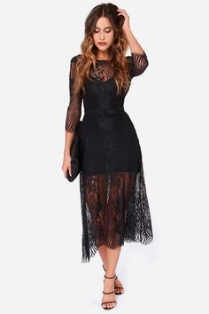 There's nothing more gorgeous than black and lace coming together to form the For Love & Lemons San Marcos Black Lace Maxi Dress ... it's modern fashion at its finest! Beautiful floral embroidery embellishes black mesh, across the bodice and deep plunging back, as well as the long sheer sleeves that end with eyelash hems. A banded waist tops the graceful maxi skirt that drapes to a scalloped eyelash hem, perfect for any evening occasion. Hidden side zipper. Dress is lined to mid-thigh. Model…