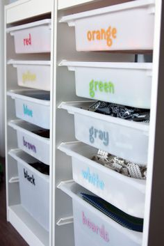 mommo design: IKEA HACKS FOR KIDS - Paper letters Mod Podged on Trofast bins for a perfect LEGO organization.