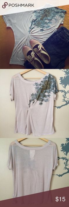 "Anthropologie Gathered T-Shirt Light grey, soft and stretchy tissue tee from Anthropologie by Paper Crane!  This top features a gathered detail on the side to create a nice silhouette at the waist and a flower print of teal, green, and purple over one shoulder.  It is a little on the loose side and could fit a size large as well.  It is 90% rayon, 10% silk and should be hand washed only.  This top is approximately 24"" long, has been worn a couple times, and is in good condition except for…"