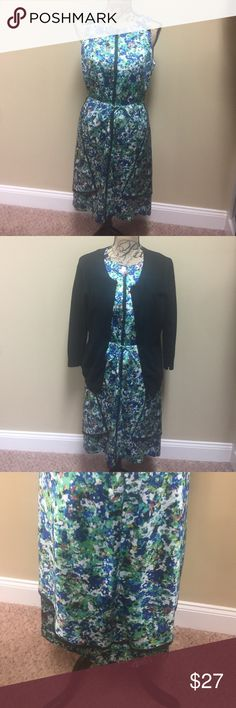 Ann Taylor: Multi-Color Dress, Gorgeous Multi-Color Dress that ties in the front. This dress has many fun colors...Blue, Coral, Cream, Black, Mint Green.  Can be paired with jacket or cardigan if desired. I took a picture of the bottom back. Ann Taylor Dresses Midi
