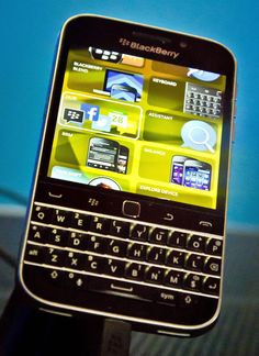 BlackBerry's new BlackBerry Classic phone appears on display during a news conference, in New York. BlackBerry's new Classic aims to please its core users who love a physical keyboard.