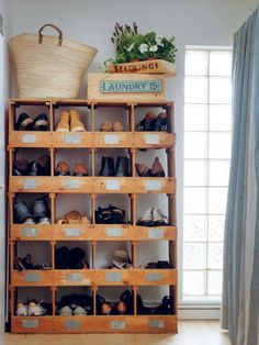 Required Reading: Living Beautifully by Cabbages and Roses founder Christna Strutt, Photograph by Simon Brown, shoe storage in vintage baker's tray holder, shabby chic | Remodelista