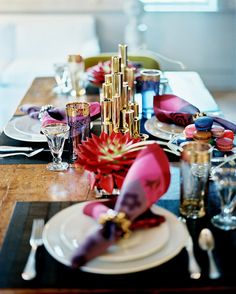 A Toast to Holiday Cheer - A gilded centerpiece and vintage glassware combined with colorful place settings results in festive decor.