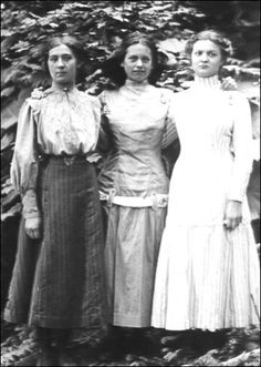 These are three of the 16 children borne by Carrie Thompson Cole and they wear fashions common on the frontier at the turn of the century.