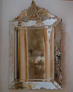 I could find an old frame at a thrift store and spraypaint it with chrome spray to give it that vintage mirror effect!