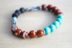 SACRED // Red Jasper Essential Oil Diffuser Bracelet with Turquoise-Dyed Wooden Beads and Vintage Southwest-inspired Beads — click the picture to purchase on www.mumblesandthings.com