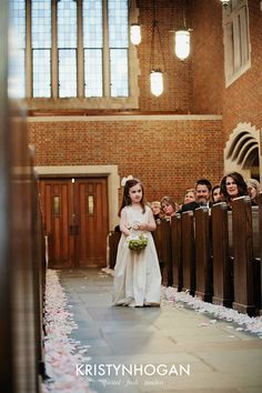 wedding isle with flower pedals on both sides and flower girl with blush and white flowers