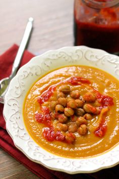 Velvety smooth and sweet carrot, squash, and coriander soup gets spiced up with a crunchy harissa chickpea topping. Healthy Vegetarian Meal Plan, Healthy Comfort Food, Healthy Recipes, Vegetarian Soups, Chili Recipes, Soup Recipes, Coriander Soup, Easy Family Meals, Family Recipes
