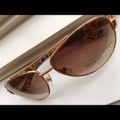 Here Comes The Sun Rose gold metal aviators with brown UV lenses and animal print temples. NWOT. Perfect condition. Case included. Nine West Accessories Sunglasses