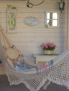 White porch with hamock and vintage shabby chic pretties
