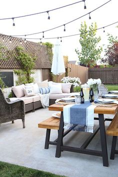 World Market outdoor furniture sale. July 2016. Up to 50% off. Outdoor dining with benches. String lights, outdoor couch with lounge.