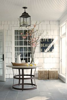 The clapboards are cozy and inviting, the table is cool, and the wall is clever.