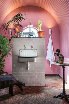 Pink bathroom with an arched ceiling
