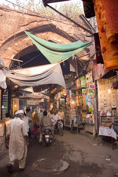 Street in Lahore ~ the capital of the Pakistani province of Punjab and the second largest city in the country. With a rich history dating back over a millennium, Lahore is a main cultural centre of Pakistan. One of the most densely populated cities in the world.