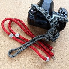 Kumihimo Camera strap / 冠組 / 12 Strand gaucho braid (right; grey) and 8 strand square braid Camera strap (left; red)