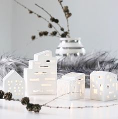 Mitt Lille Hjerte: URBANIALOVE... Little Ceramic Candel Houses. I like the touch of modernism in this small collection, very good looking